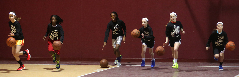A dribbling drill has most of the team sprinting downcourt in unison. From left to right: Laura Kaiser, Kaleah Toran, Naudiyah Rucker-Cook, Anne Rupnik, Lauren Schrage, Anna Chambers. The Central Illinois Xpress girls basketball team, made up of local fifth grade students, has consistently been beating boys teams from the Midwest. They practice here at Abundant Faith Christian Center gymnasium in Springfield on Friday, Jan. 24, 2015.  David Spencer/The State Journal-Register