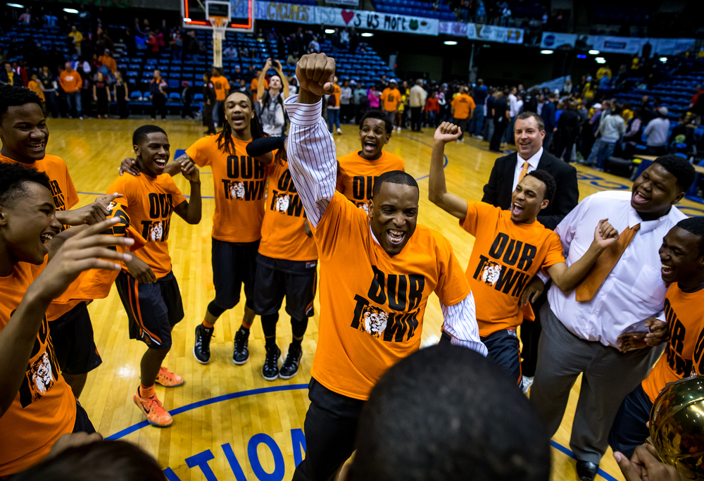 Lanphier head coach Blake Turner dances with the team as the Lions celebrate their 68-16 victory over Southeast to win the 2015 Boys City Tournament at the Prairie Capital Convention Center, Saturday, Jan. 24, 2015, in Springfield, Ill. Justin L. Fowler/The State Journal-Register