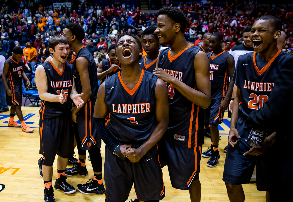 Lanphier's Yaakema Rose (1) and the Lions begin to celebrate after they beat Southeast 68-61 to win the 2015 Boys City Tournament at the Prairie Capital Convention Center, Saturday, Jan. 24, 2015, in Springfield, Ill. Justin L. Fowler/The State Journal-Register