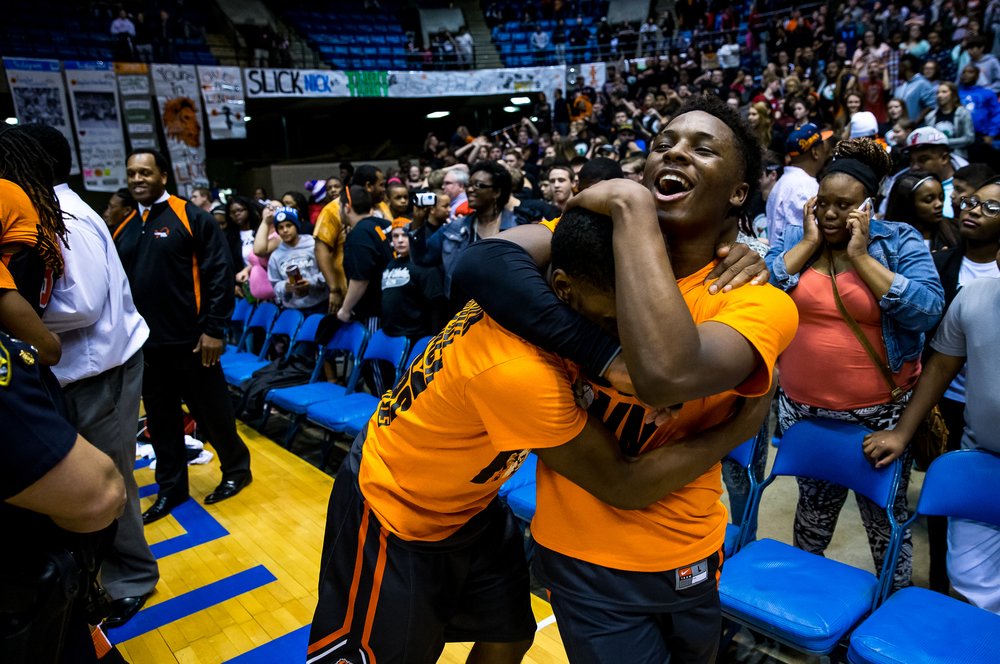 Lanphier's Yaakema Rose (1) and Xavier Bishop (5) celebrate after the Lions defeated Southeast 68-61 to win the 2015 Boys City Tournament at the Prairie Capital Convention Center, Saturday, Jan. 24, 2015, in Springfield, Ill. Justin L. Fowler/The State Journal-Register