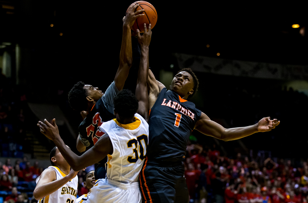 Lanphier's Aundrae Williams (23) and Yaakema Rose (1) go for a rebound against Southeast's D'Angelo Hughes (30) in the second half during game two of the 2015 Boys City Tournament at the Prairie Capital Convention Center, Saturday, Jan. 24, 2015, in Springfield, Ill. Justin L. Fowler/The State Journal-Register