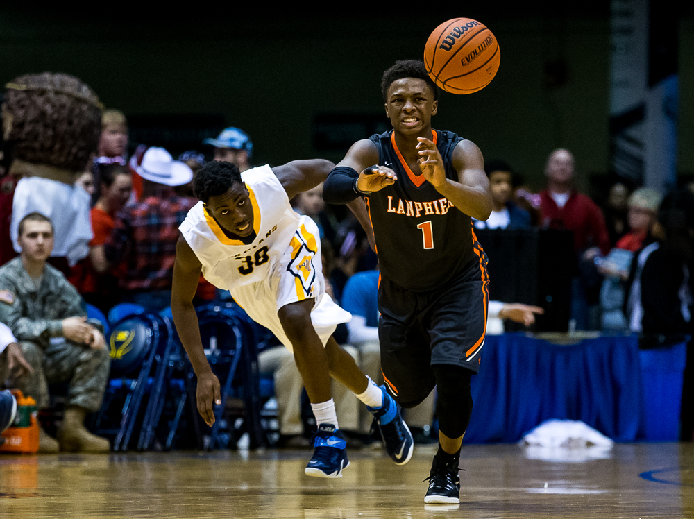 Lanphier's Yaakema Rose (1) manages to get the ball out to a teammate while under pressure from Southeast's D'Angelo Hughes (30) in the second half during game two of the 2015 Boys City Tournament at the Prairie Capital Convention Center, Saturday, Jan. 24, 2015, in Springfield, Ill. Justin L. Fowler/The State Journal-Register