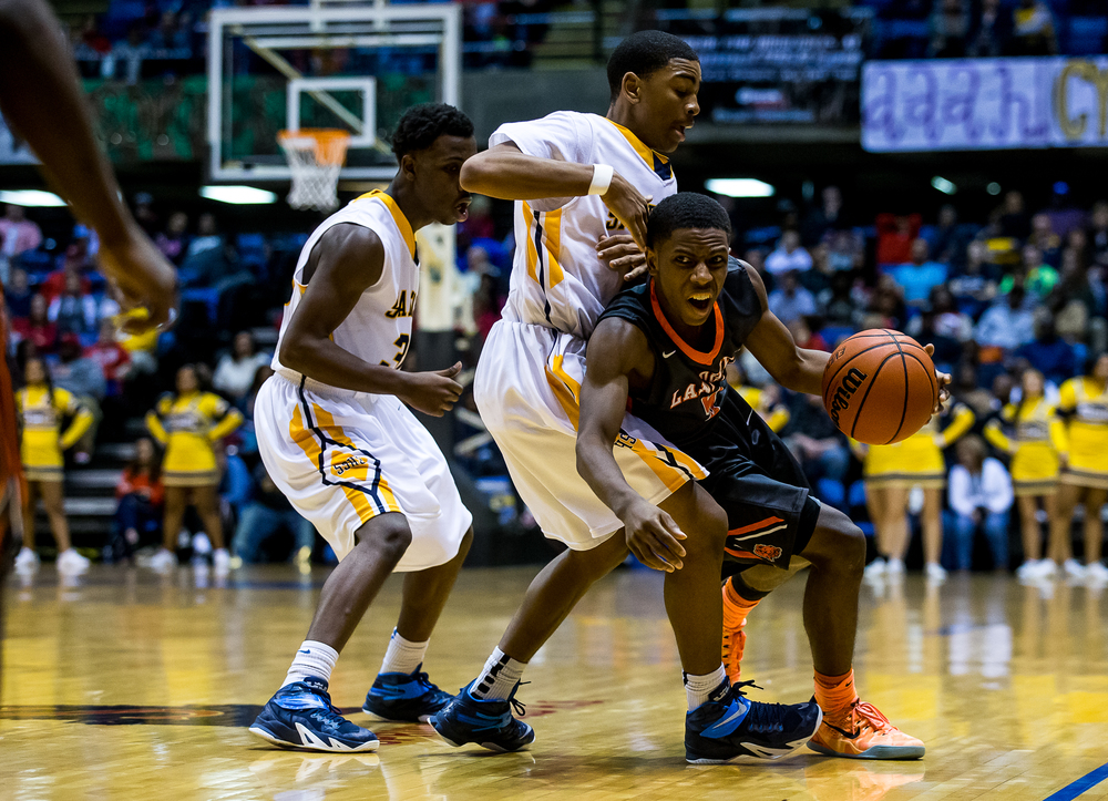 Lanphier's Xavier Bishop (5) dribbles out of the pressure from Southeast's Trevyon Williams (4) in the second half during game two of the 2015 Boys City Tournament at the Prairie Capital Convention Center, Saturday, Jan. 24, 2015, in Springfield, Ill. Justin L. Fowler/The State Journal-Register