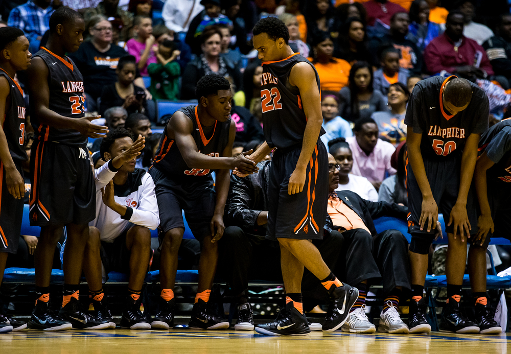 Lanphier's Daryl Jackson (22) heads to the bench after fouling out against Southeast in the second half during game two of the 2015 Boys City Tournament at the Prairie Capital Convention Center, Saturday, Jan. 24, 2015, in Springfield, Ill. Justin L. Fowler/The State Journal-Register