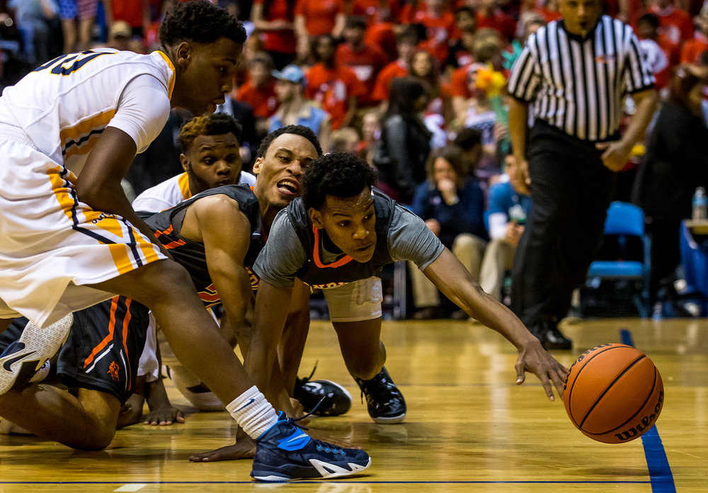 Lanphier's Aundrae Williams (23) dives to try and save a loose ball before going out of bounds on the Lions as they take on Southeast in the first half during game two of the 2015 Boys City Tournament at the Prairie Capital Convention Center, Saturday, Jan. 24, 2015, in Springfield, Ill. Justin L. Fowler/The State Journal-Register