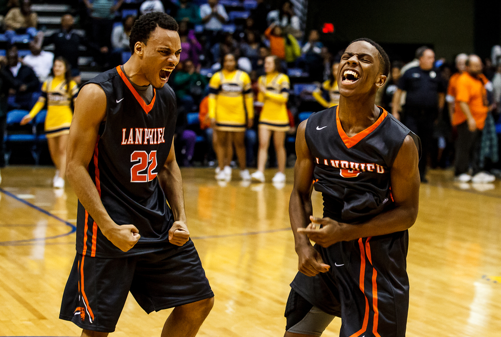 Lanphier's Xavier Bishop (5) and Daryl Jackson (22) celebrate after the Lions defeated Southeast 68-61 to win the 2015 Boys City Tournament at the Prairie Capital Convention Center, Saturday, Jan. 24, 2015, in Springfield, Ill. Justin L. Fowler/The State Journal-Register