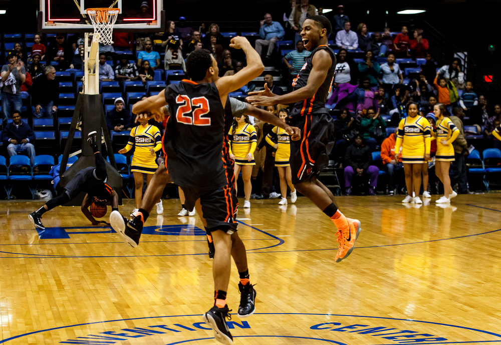 Lanphier's Xavier Bishop (5) leaps up to celebrate with Daryl Jackson (22) and Aundrae Williams (23) after the Lions defeated Southeast 68-61 in the 2015 Boys City Tournament at the Prairie Capital Convention Center, Saturday, Jan. 24, 2015, in Springfield, Ill. Justin L. Fowler/The State Journal-Register