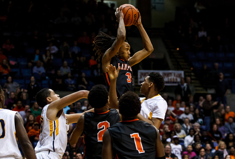 Lanphier's Aarin Thames (3) pulls in a rebound against Southeast in the second half during game two of the 2015 Boys City Tournament at the Prairie Capital Convention Center, Saturday, Jan. 24, 2015, in Springfield, Ill. Justin L. Fowler/The State Journal-Register