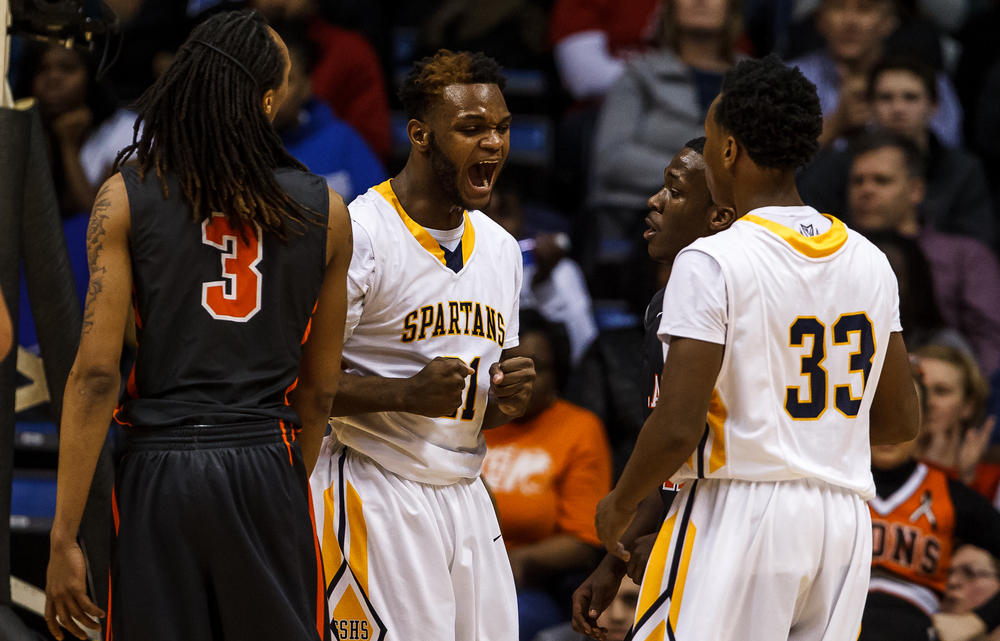 Southeast's D.J. Crawford (21) screams out after drawing a foul while going for a shot against Lanphier in the first half during game two of the 2015 Boys City Tournament at the Prairie Capital Convention Center, Saturday, Jan. 24, 2015, in Springfield, Ill. Justin L. Fowler/The State Journal-Register