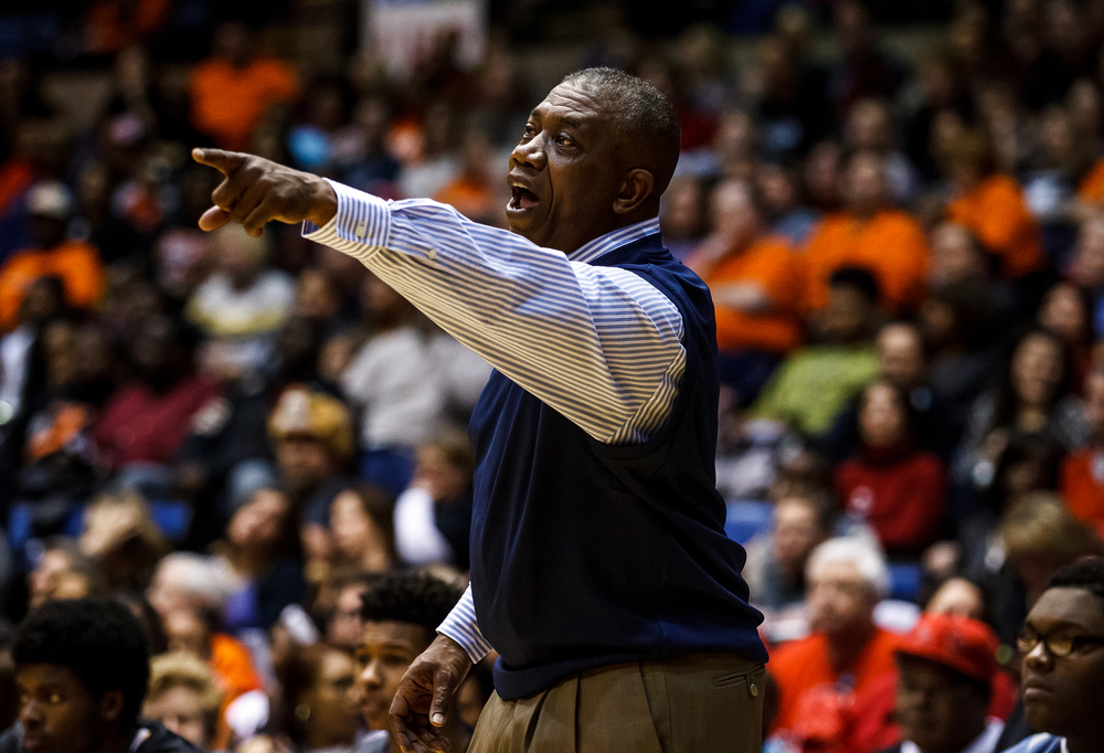 Southeast boys basketball head coach Lawrence Thomas sends a play into the team as they take on Lanphier in the first half during game two of the 2015 Boys City Tournament at the Prairie Capital Convention Center, Saturday, Jan. 24, 2015, in Springfield, Ill. Justin L. Fowler/The State Journal-Register