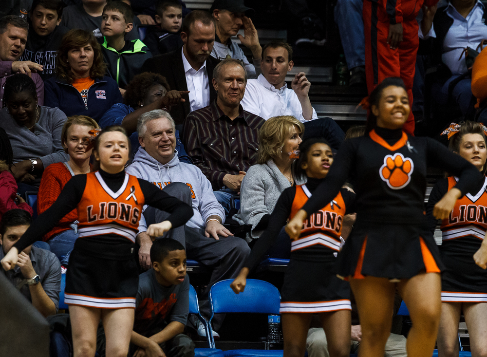 Illinois Gov. Bruce Rauner takes in the Lanphier vs. Southeast game from the stands during game two of the 2015 Boys City Tournament at the Prairie Capital Convention Center, Saturday, Jan. 24, 2015, in Springfield, Ill. Justin L. Fowler/The State Journal-Register