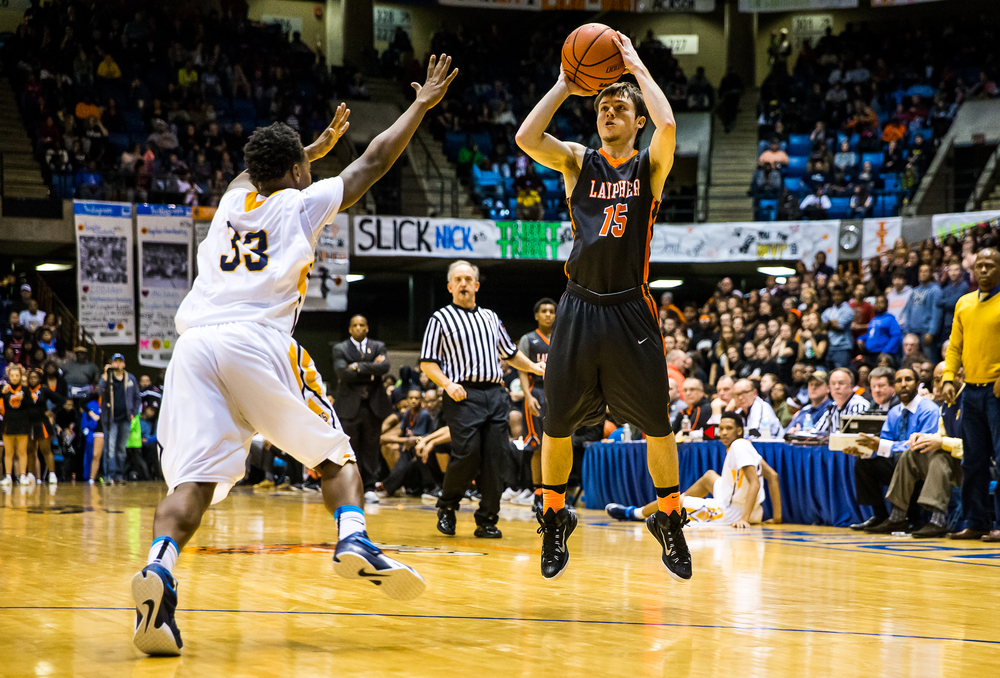 Lanphier's Nick Patton (15) puts up a three against Southeast's Mark Johnson (33) in the first half during game two of the 2015 Boys City Tournament at the Prairie Capital Convention Center, Saturday, Jan. 24, 2015, in Springfield, Ill. Justin L. Fowler/The State Journal-Register