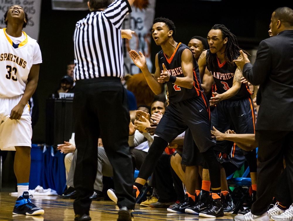 Lanphier's Cardell McGee (2) reacts after drawing the foul form Southeast's Mark Johnson (33) as they went for a loose ball in the first half during game two of the 2015 Boys City Tournament at the Prairie Capital Convention Center, Saturday, Jan. 24, 2015, in Springfield, Ill. Justin L. Fowler/The State Journal-Register