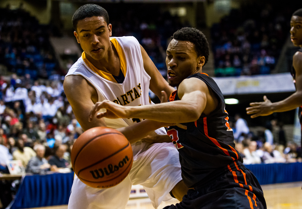 Lanphier's Daryl Jackson (22) and Southeast's Harrison Devoe (31) battle for a loose ball underneath the basket in the first half during game two of the 2015 Boys City Tournament at the Prairie Capital Convention Center, Saturday, Jan. 24, 2015, in Springfield, Ill. Justin L. Fowler/The State Journal-Register