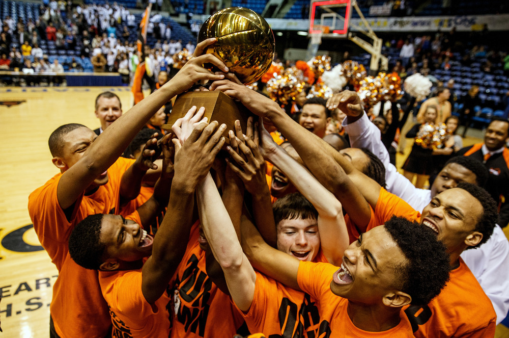 The Lanphier Lions hoist up the trophy after defeating Southeast 68-61 to win the 2015 Boys City Tournament at the Prairie Capital Convention Center, Saturday, Jan. 24, 2015, in Springfield, Ill. Justin L. Fowler/The State Journal-Register