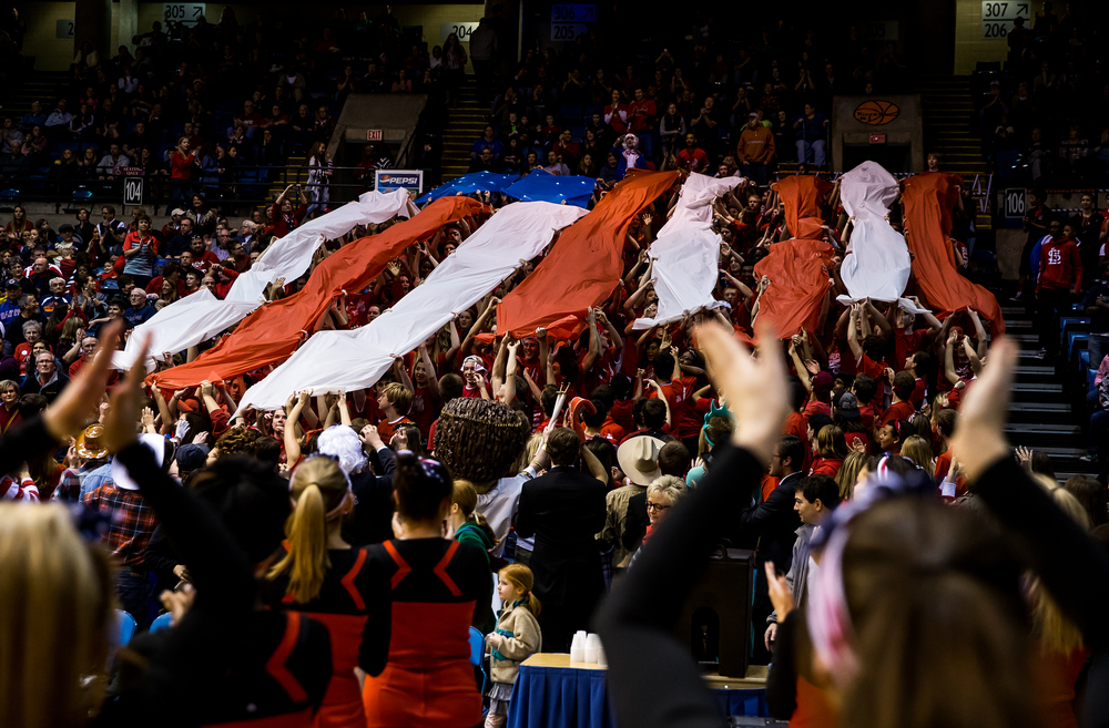 The Springfield High School student section rolls out an American flag design as the Senators take on Sacred Heart-Griffin in the first half during game one of the 2015 Boys City Tournament at the Prairie Capital Convention Center, Saturday, Jan. 24, 2015, in Springfield, Ill. Justin L. Fowler/The State Journal-Register