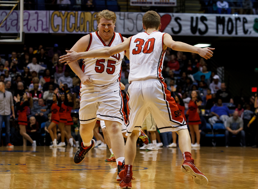 Springfield's Logan Winders (55) and Springfield's Blain Keene (30) celebrate after Winders made a steal against Sacred Heart-Griffin in the second half during game one of the 2015 Boys City Tournament at the Prairie Capital Convention Center, Saturday, Jan. 24, 2015, in Springfield, Ill. Justin L. Fowler/The State Journal-Register
