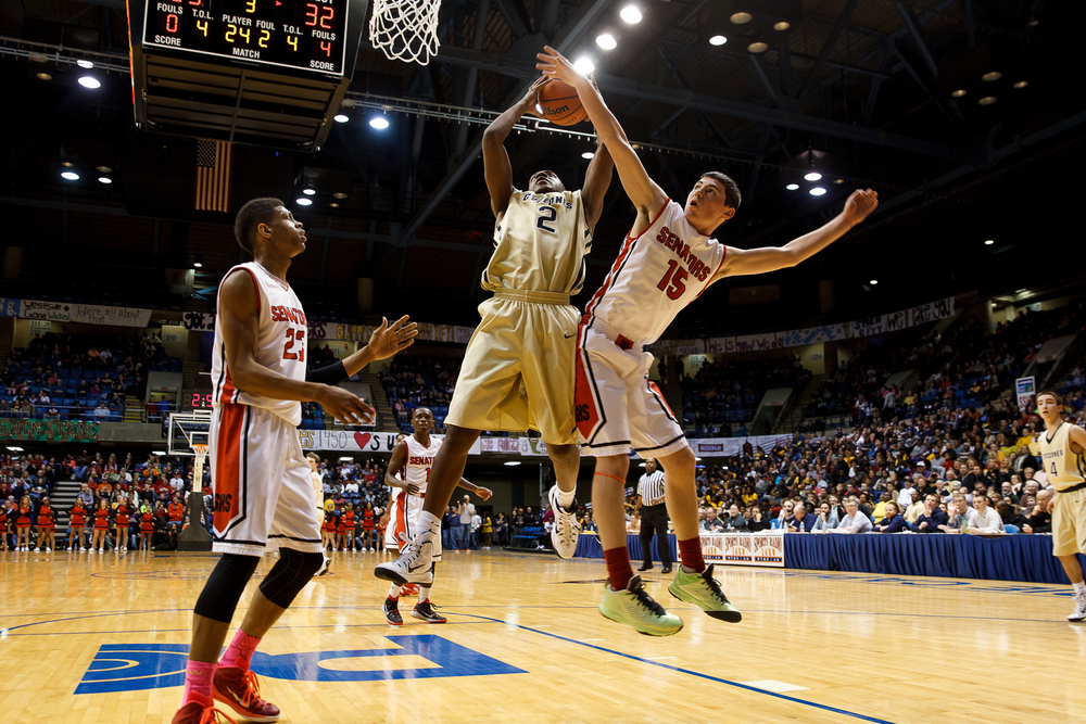 Sacred Heart-Griffin's Avery Andrews (2) pulls in a rebound against Springfield's Trevor Minder (15) in the second half during game one of the 2015 Boys City Tournament at the Prairie Capital Convention Center, Saturday, Jan. 24, 2015, in Springfield, Ill. Justin L. Fowler/The State Journal-Register