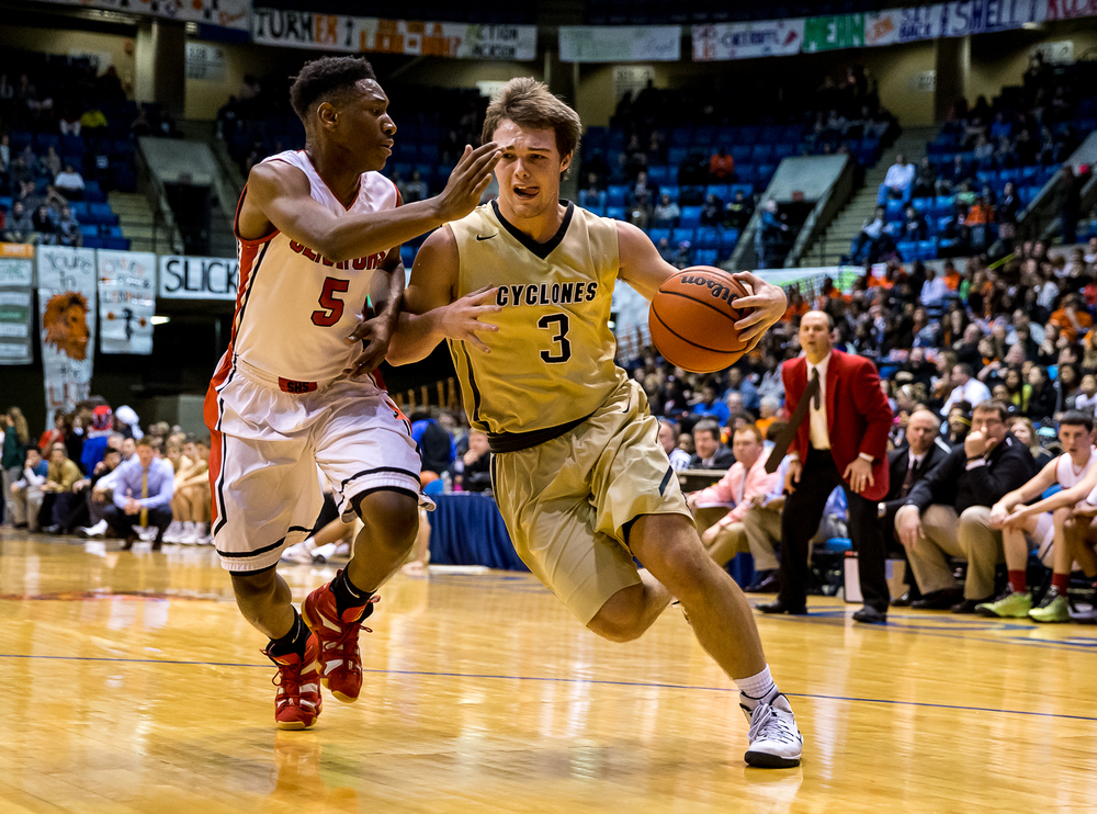 Sacred Heart-Griffin's Gabe Green (3) drives to the basket against Springfield's Isaac Nelson (5) in the first half during game one of the 2015 Boys City Tournament at the Prairie Capital Convention Center, Saturday, Jan. 24, 2015, in Springfield, Ill. Justin L. Fowler/The State Journal-Register