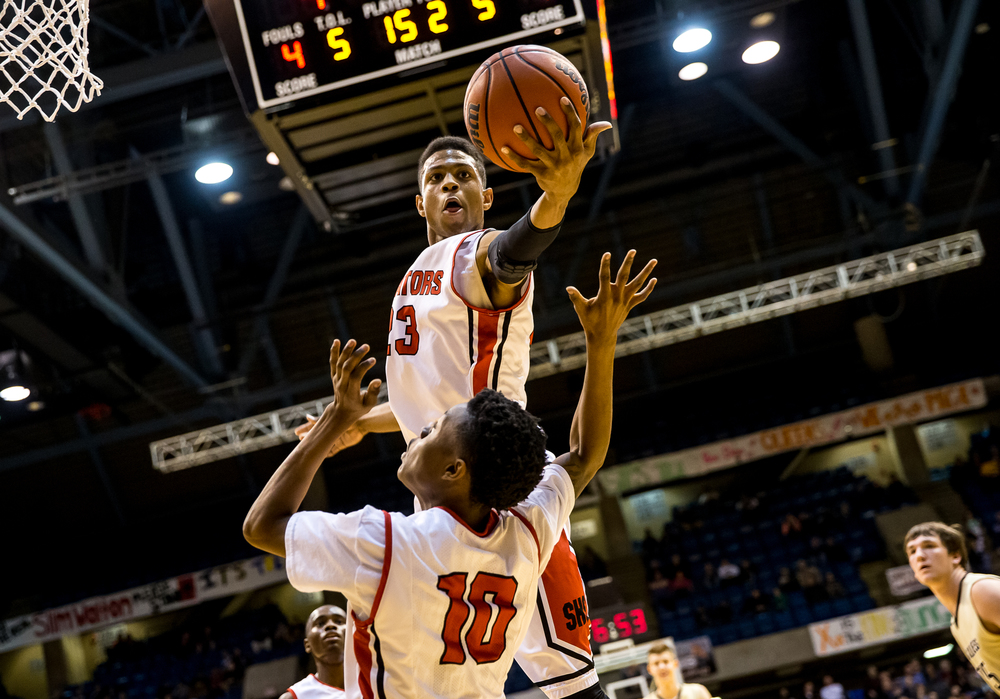 Springfield's Obediah Church (23) pulls in a rebound against SHG in the first half during game one of the 2015 Boys City Tournament at the Prairie Capital Convention Center, Saturday, Jan. 24, 2015, in Springfield, Ill. Justin L. Fowler/The State Journal-Register