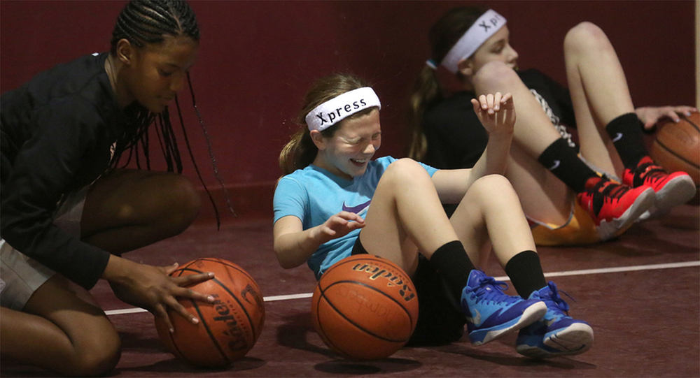 "A dribbling drill has Anna Chambers, center, nickname ""Banana,"" grimacing during practice with the Chatham-based Central Illinois Xpress girls basketball team. The fifth-grade girls gained a place in the national spotlight when they were profiled in The New York Times. They have an 8-3 record against other teams in the league, which are all boys. They practiced at the Abundant Faith Christian Center's gymnasium Friday, Jan. 24, 2015. David Spencer/The State Journal-Register"""