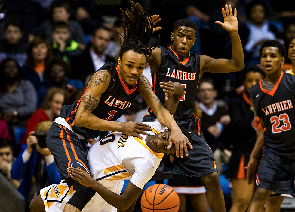 Lanphier's Aarin Thames (3) fouls Southeast's D'Angelo Hughes (30) as he went for a loose ball in the first half during game two of the 2015 Boys City Tournament at the Prairie Capital Convention Center, Saturday, Jan. 24, 2015, in Springfield, Ill. Justin L. Fowler/The State Journal-Register