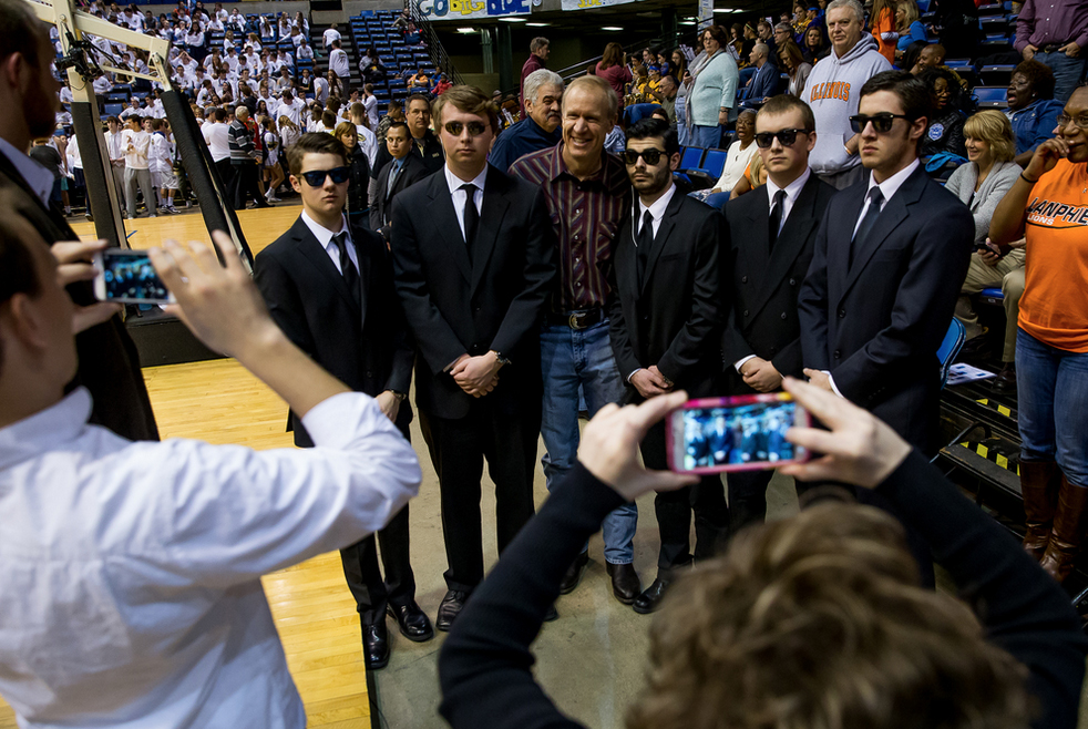 Illinois Gov. Bruce Rauner poses with Springfield High School students dressed as security guards during the 2015 Boys City Tournament at the Prairie Capital Convention Center, Saturday, Jan. 24, 2015, in Springfield, Ill. Justin L. Fowler/The State Journal-Register