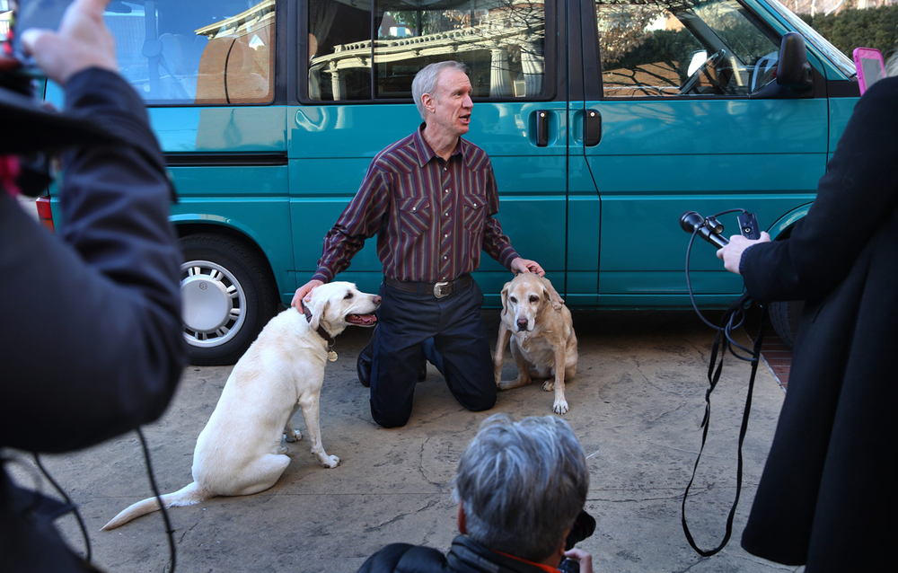 Gov. Bruce Rauner introduces his female Labrador retrievers, Stella, left, and Pumpkin, to the news media Saturday, Jan. 24, 2015 in the driveway of the Executive Mansion. David Spencer/The State Journal-Register