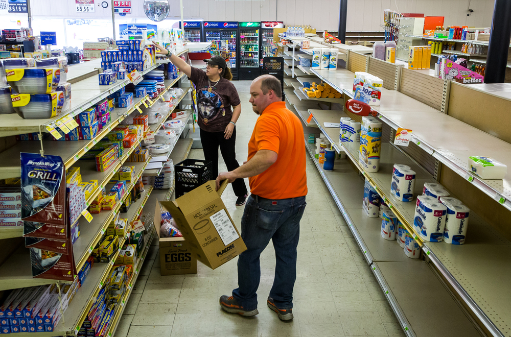 Tom Hunt, the owner and manger of the Pawnee Food Center, packs up the stores usable inventory to take it to a grocery store that he owns in Taylorville, as the store is prepared to close on its final day, Saturday, Jan. 24, 2015, in Pawnee, Ill. Justin L. Fowler/The State Journal-Register