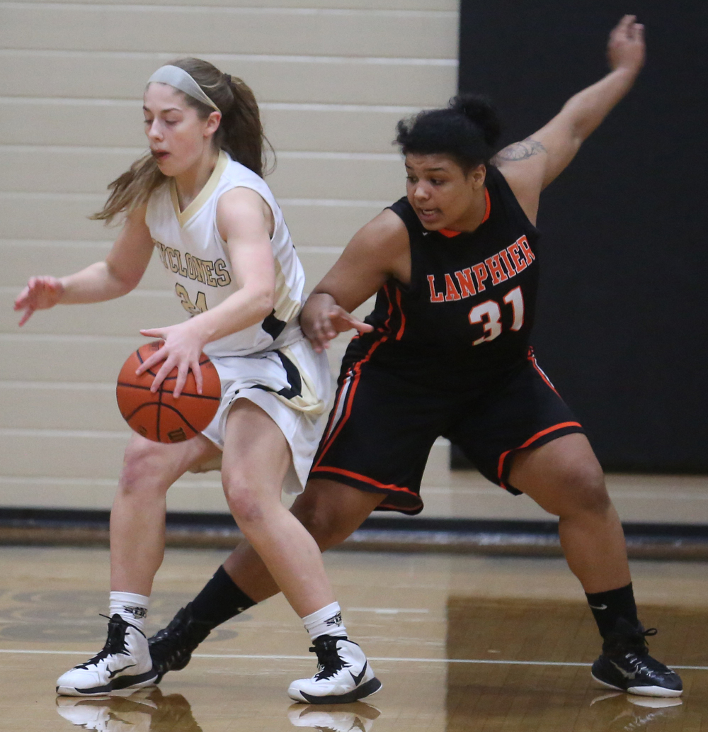 SHG player Anna Lowis spins to evade Lanphier defender Keona Bolden. Sacred Heart Griffin defeated Lanphier 43-29 during second night action at the Girls City Basketball Tournament held at Belz Gym at Sacred Heart-Griffin's west campus in Springfield on Wednesday evening, Jan. 28, 2015. David Spencer/The State Journal-Register