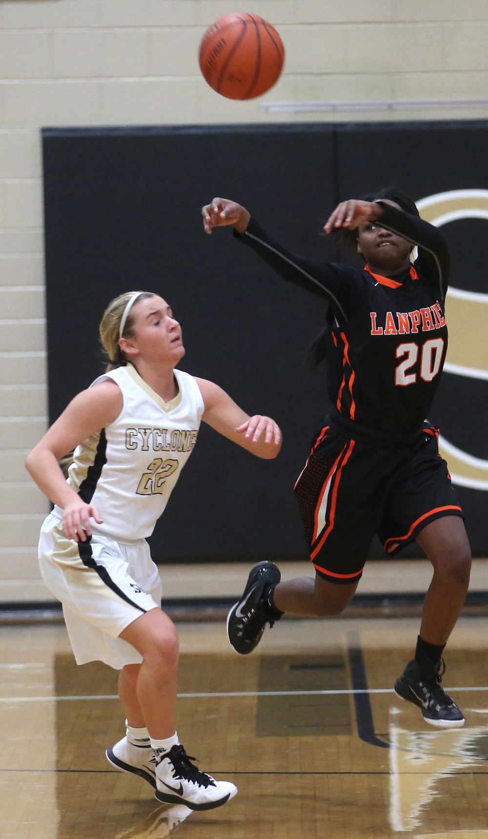 Lanphier player Arrion Burton passes over SHG defender Katie McLean. Sacred Heart Griffin defeated Lanphier 43-29 during second night action at the Girls City Basketball Tournament held at Belz Gym at Sacred Heart-Griffin's west campus in Springfield on Wednesday evening, Jan. 28, 2015. David Spencer/The State Journal-Register