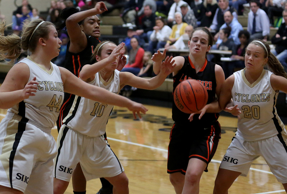 Lanphier player Maria Cline tries to gain control of a loose ball along with SHG players left to right: Chloe Albert, Dani Healey, Kaylin Tate. Sacred Heart Griffin defeated Lanphier 43-29 during second night action at the Girls City Basketball Tournament held at Belz Gym at Sacred Heart-Griffin's west campus in Springfield on Wednesday evening, Jan. 28, 2015. David Spencer/The State Journal-Register