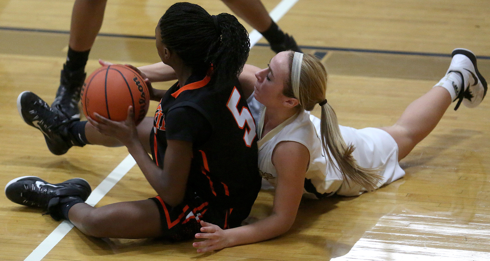 From the floor, SHG player Dani Healey tries to deflect a pass being made by Lanphier's Jeniya Griffin. Sacred Heart Griffin defeated Lanphier 43-29 during second night action at the Girls City Basketball Tournament held at Belz Gym at Sacred Heart-Griffin's west campus in Springfield on Wednesday evening, Jan. 28, 2015. David Spencer/The State Journal-Register