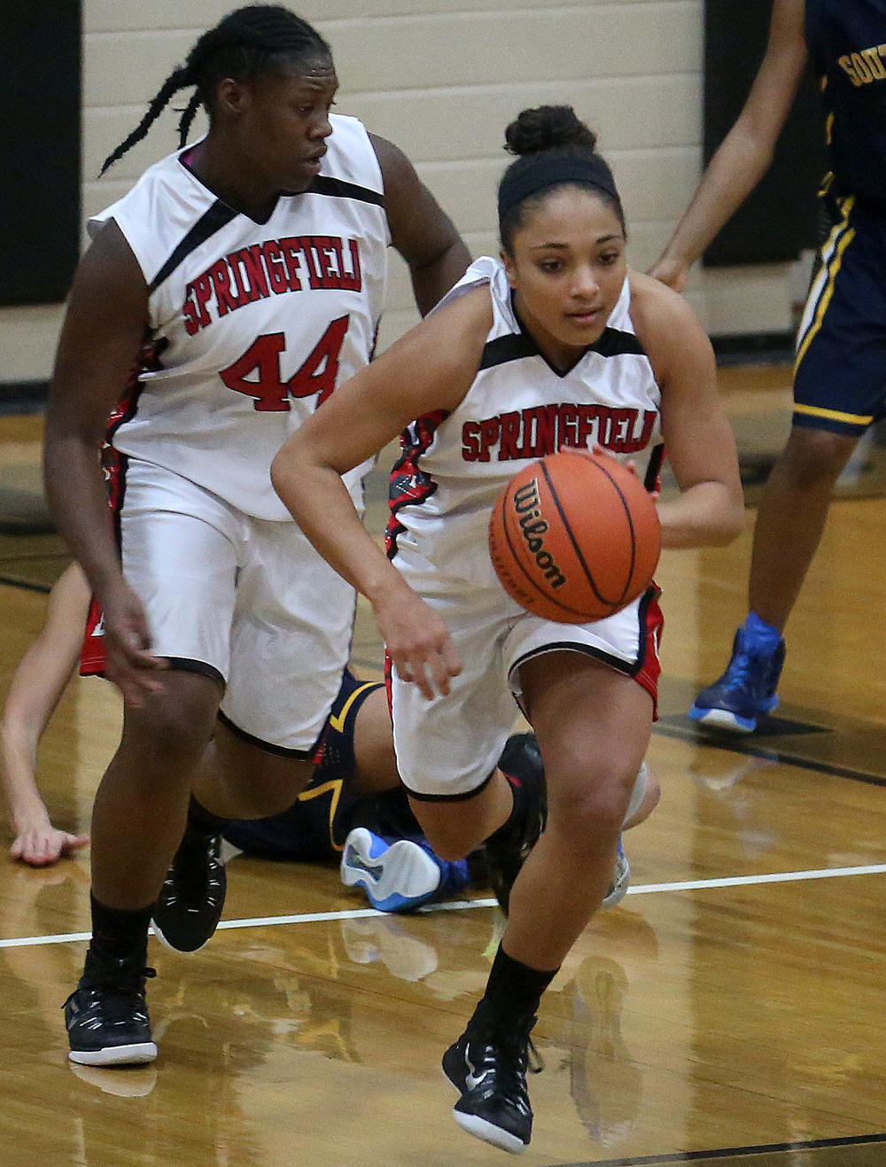 Springfield's Kyra Webster sprints up court with the ball while being covered by teammate Montshianna Pulliam. Springfield High defeated Southeast 49-35 during second night action at the Girls City Basketball Tournament held at Belz Gym at Sacred Heart-Griffin's west campus in Springfield on Wednesday evening, Jan. 28, 2015. David Spencer/The State Journal-Register