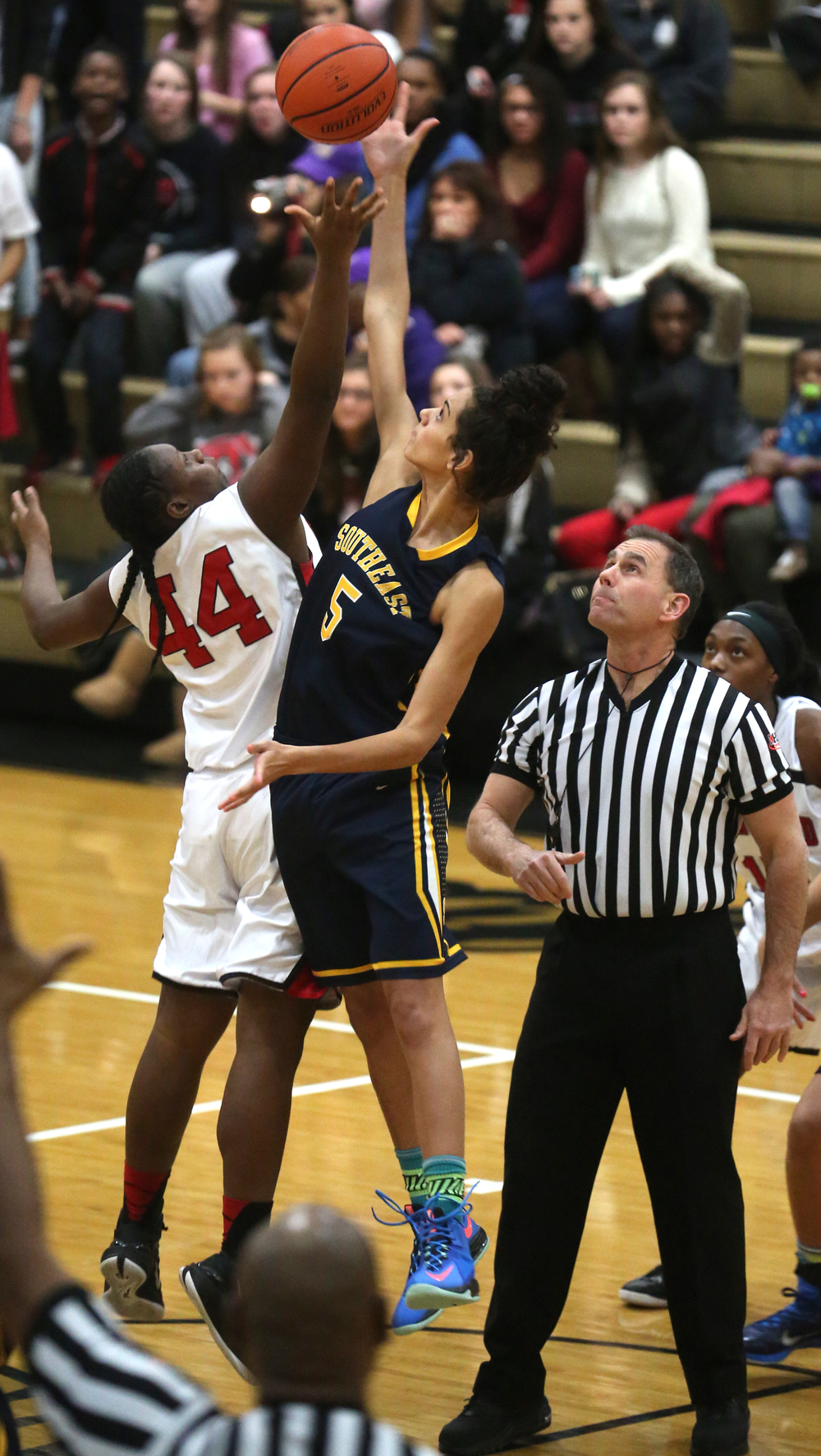 Tipping off to start the game was Springfield's Montshianna Pulliam at left and Southeast player Lunden Henry. Springfield High defeated Southeast 49-35 during second night action at the Girls City Basketball Tournament held at Belz Gym at Sacred Heart-Griffin's west campus in Springfield on Wednesday evening, Jan. 28, 2015. David Spencer/The State Journal-Register