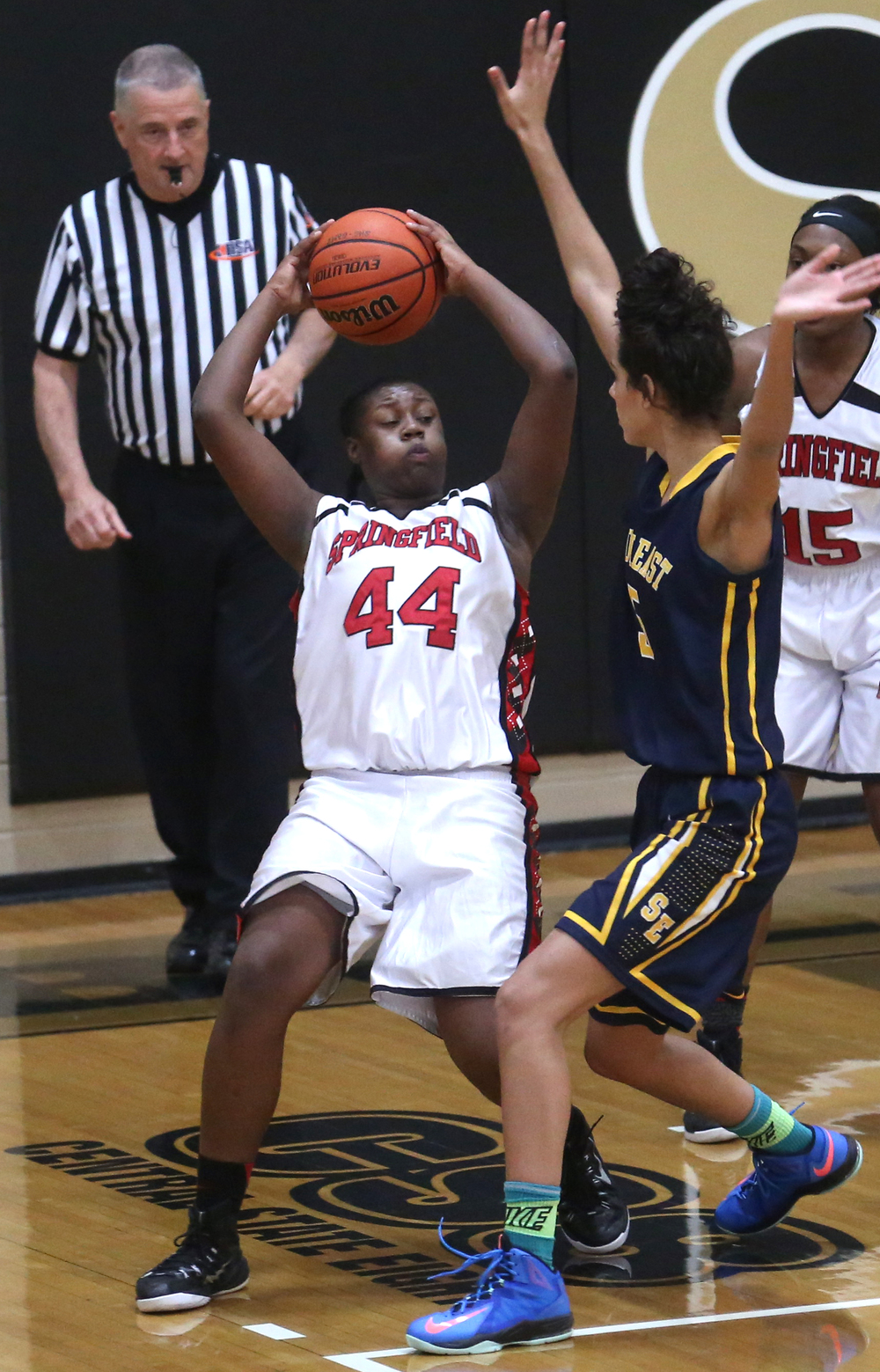 Springfield's Montshianna Pulliam tries to get around Southeast's Lunden Henry. Springfield High defeated Southeast 49-35 during second night action at the Girls City Basketball Tournament held at Belz Gym at Sacred Heart-Griffin's west campus in Springfield on Wednesday evening, Jan. 28, 2015. David Spencer/The State Journal-Register