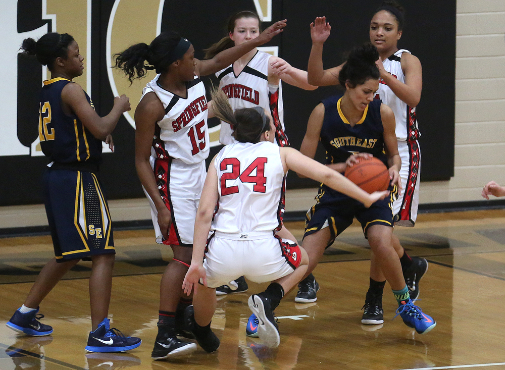 Southeast player Lunden Henry is surrounded by Springfield defenders. Springfield High defeated Southeast 49-35 during second night action at the Girls City Basketball Tournament held at Belz Gym at Sacred Heart-Griffin's west campus in Springfield on Wednesday evening, Jan. 28, 2015. David Spencer/The State Journal-Register