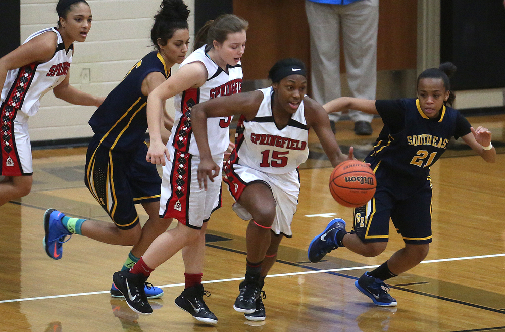 Springfield player Kierra Weir sprints up court with the ball. Springfield High defeated Southeast 49-35 during second night action at the Girls City Basketball Tournament held at Belz Gym at Sacred Heart-Griffin's west campus in Springfield on Wednesday evening, Jan. 28, 2015. David Spencer/The State Journal-Register