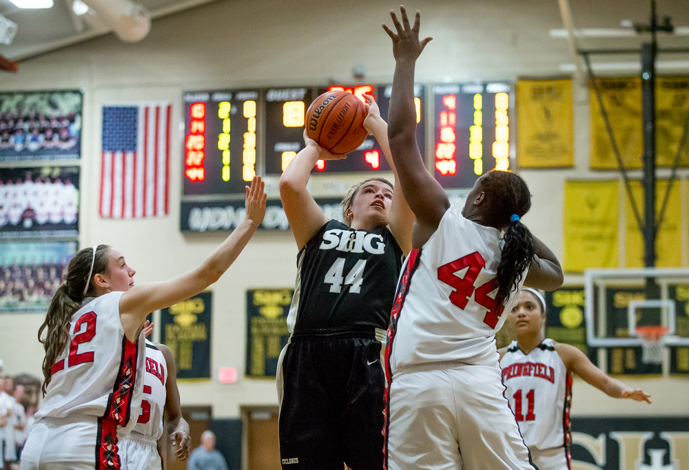 Sacred Heart-Griffin's Chloe Albert (44) goes up for a shot against Springfield's Montshianna Pulliam (44) in the second half during the 2015 Girls City Tournament at Jim Belz Gymnasium, Thursday, Jan. 29, 2015, in Springfield, Ill. Justin L. Fowler/The State Journal-Register
