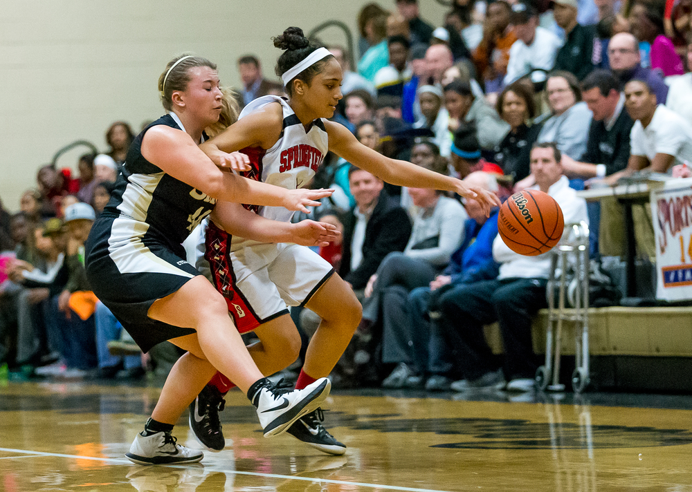 Springfield's Kyra Webster (11) protects the ball under pressure from Sacred Heart-Griffin's Chloe Albert (44) in the first half during the 2015 Girls City Tournament at Jim Belz Gymnasium, Thursday, Jan. 29, 2015, in Springfield, Ill. Justin L. Fowler/The State Journal-Register