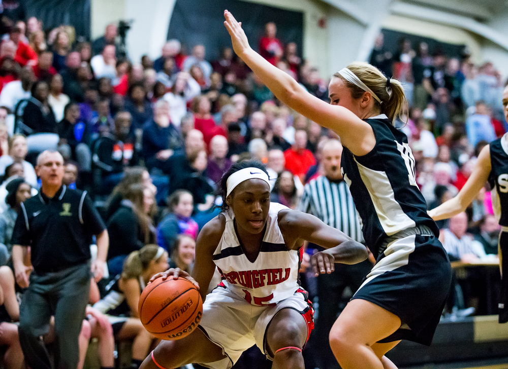Springfield's Kierra Weir (15) tries to dribble around the defense of Sacred Heart-Griffin's Dani Healey (10) in the first half during the 2015 Girls City Tournament at Jim Belz Gymnasium, Thursday, Jan. 29, 2015, in Springfield, Ill. Justin L. Fowler/The State Journal-Register