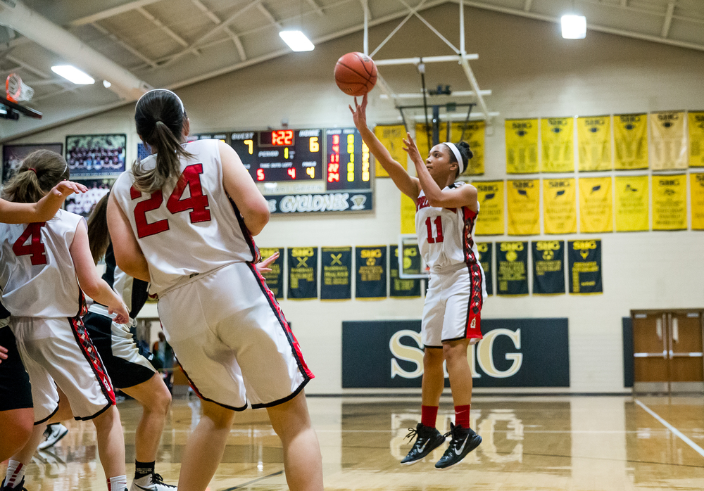 Springfield's Kyra Webster (11) puts up a shot against Sacred Heart-Griffin in the first half during the 2015 Girls City Tournament at Jim Belz Gymnasium, Thursday, Jan. 29, 2015, in Springfield, Ill. Justin L. Fowler/The State Journal-Register