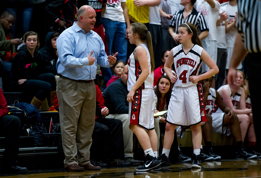 Springfield girls basketball coach Brad Scheffler talks with Springfield's Ashley Robinson (3) along the sidelines as SHG shoots free throws in the first half during the 2015 Girls City Tournament at Jim Belz Gymnasium, Thursday, Jan. 29, 2015, in Springfield, Ill. Justin L. Fowler/The State Journal-Register