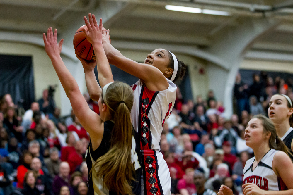 Springfield's Kyra Webster (11) puts up a shot after a rebound against Sacred Heart-Griffin's Anna Lowis (24) in the first half during the 2015 Girls City Tournament at Jim Belz Gymnasium, Thursday, Jan. 29, 2015, in Springfield, Ill. Justin L. Fowler/The State Journal-Register
