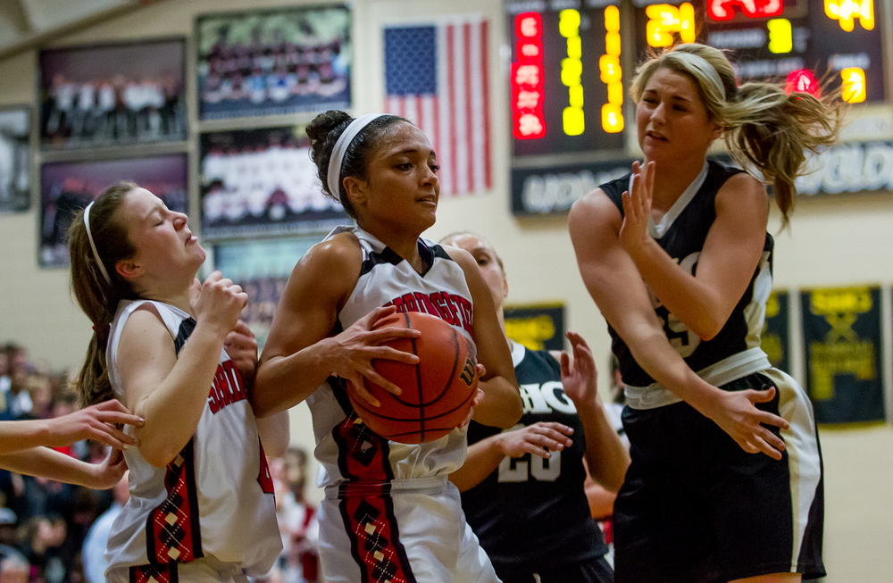 Springfield's Kyra Webster (11) pulls in a rebound against Sacred Heart-Griffin's Kenzie Trees (35) in the second half during the 2015 Girls City Tournament at Jim Belz Gymnasium, Thursday, Jan. 29, 2015, in Springfield, Ill. Justin L. Fowler/The State Journal-Register