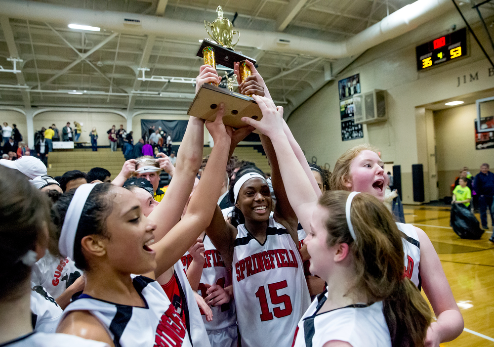 Springfield's Kierra Weir (15) celebrates with her teammates after Springfield defeated Sacred Heart-Griffin to win the 2015 Girls City Tournament at Jim Belz Gymnasium, Thursday, Jan. 29, 2015, in Springfield, Ill. Justin L. Fowler/The State Journal-Register