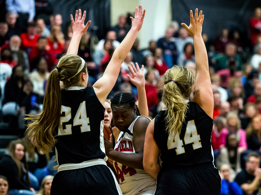 Springfield's Montshianna Pulliam (44) is double teamed by Sacred Heart-Griffin's Anna Lowis (24) and Chloe Albert (44) in the first half during the 2015 Girls City Tournament at Jim Belz Gymnasium, Thursday, Jan. 29, 2015, in Springfield, Ill. Justin L. Fowler/The State Journal-Register