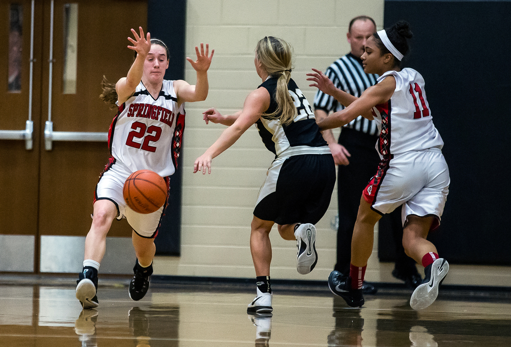 Springfield's Sarah Cross (22) forces a turnover from Sacred Heart-Griffin's Katie McLean (22) in the first half during the 2015 Girls City Tournament at Jim Belz Gymnasium, Thursday, Jan. 29, 2015, in Springfield, Ill. Justin L. Fowler/The State Journal-Register