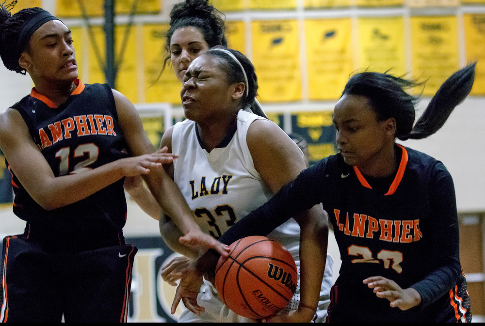 Southeast's Kelsey Alexander (33) battles for a rebound against Lanphier's Ta Mya Dumas (12) and Arrion Burton (20) in the second half during the 2015 Girls City Tournament at Jim Belz Gymnasium, Thursday, Jan. 29, 2015, in Springfield, Ill. Justin L. Fowler/The State Journal-Register