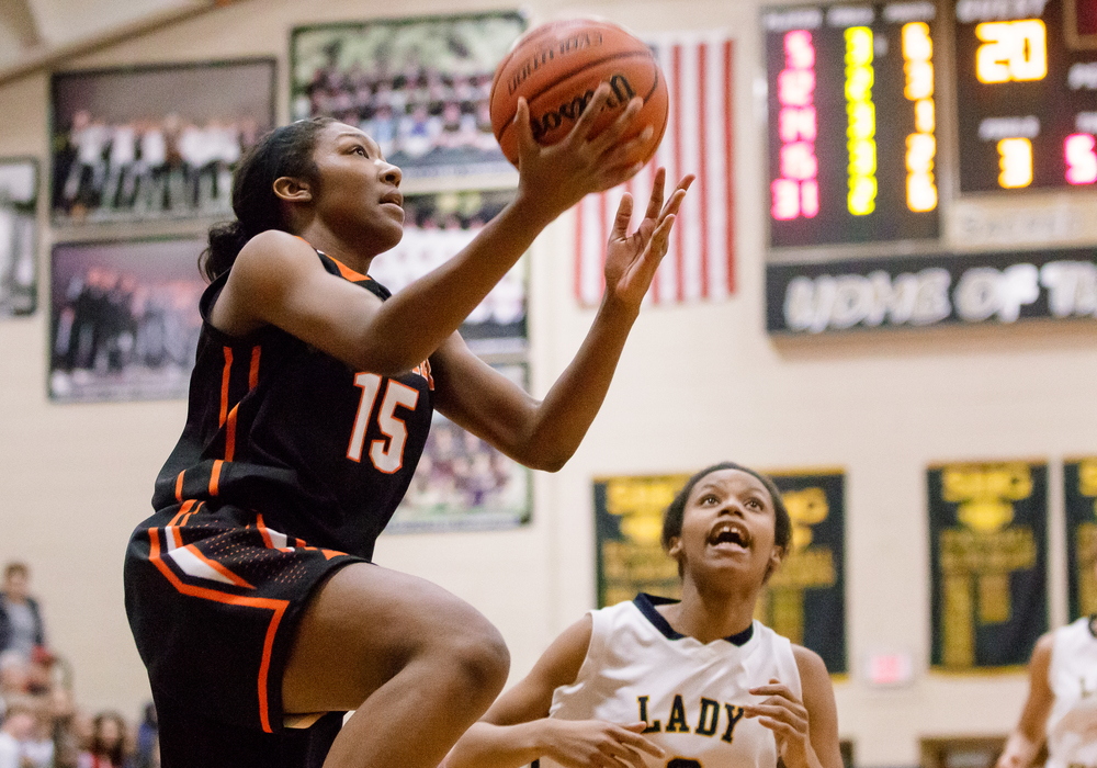 Lanphier's Sierra James (15) goes up for a layup against Southeast in the second half during the 2015 Girls City Tournament at Jim Belz Gymnasium, Thursday, Jan. 29, 2015, in Springfield, Ill. Justin L. Fowler/The State Journal-Register